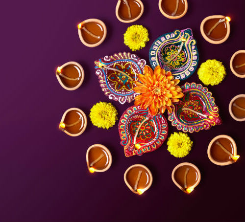 Colourful Lamps With Flowers at Diwali